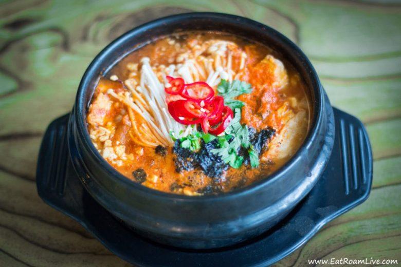 Siibdubu Jjigae - a spicy tofu stew with soft tofu, mushrooms, mock fishcake and Kimchi.