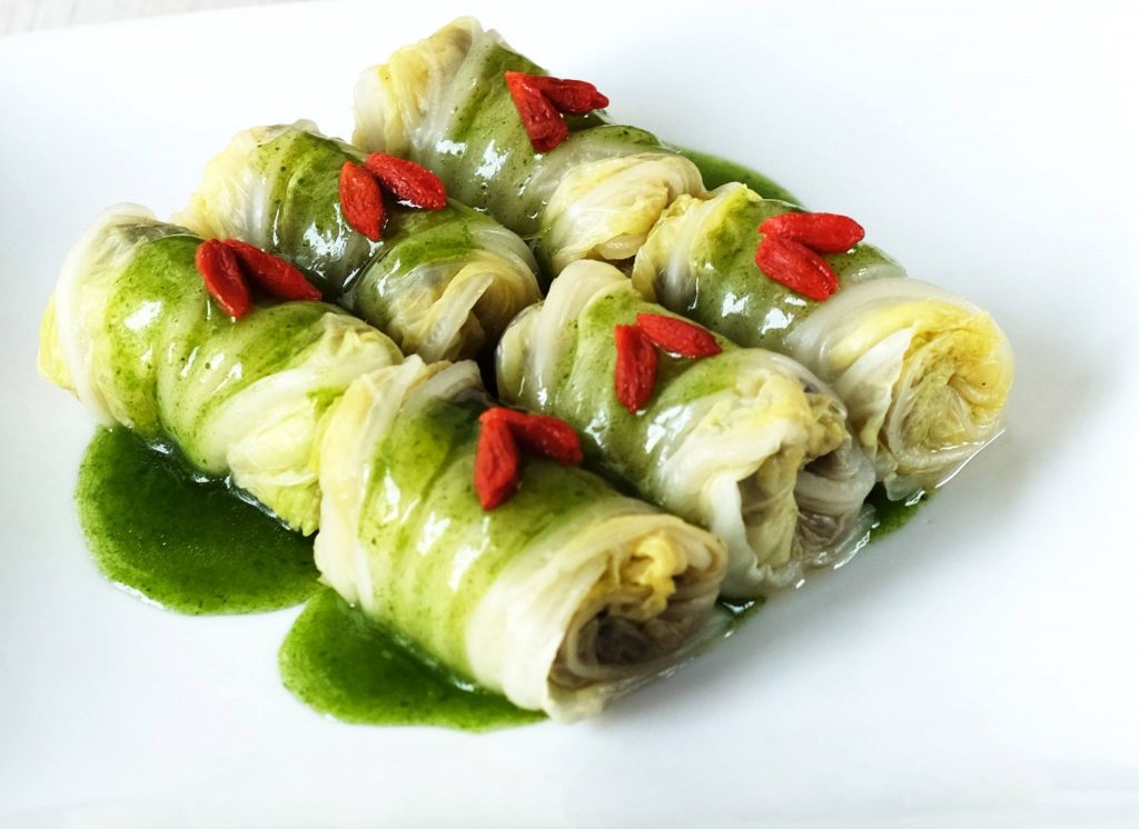 Steamed Jade Wraps: Sweet long cabbage leaves stuffed with wood ear mushrooms, bamboo pith, celery, carrots and more cabbage
